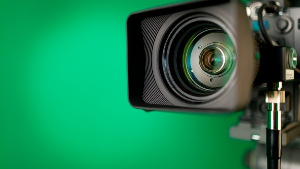Video camera over green background